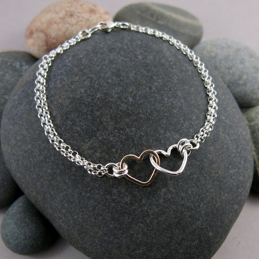Hearts Embrace Bracelet in Silver and Gold by Mikel Grant Jewellery.  Artisan made interlocking hearts bracelet.