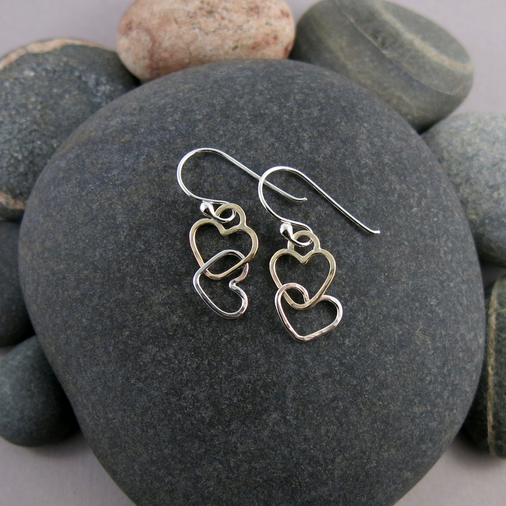 Hearts Embrace Earrings in Gold and Sterling Silver by Mikel Grant Jewellery. Artisan made interlocking hearts earrings.