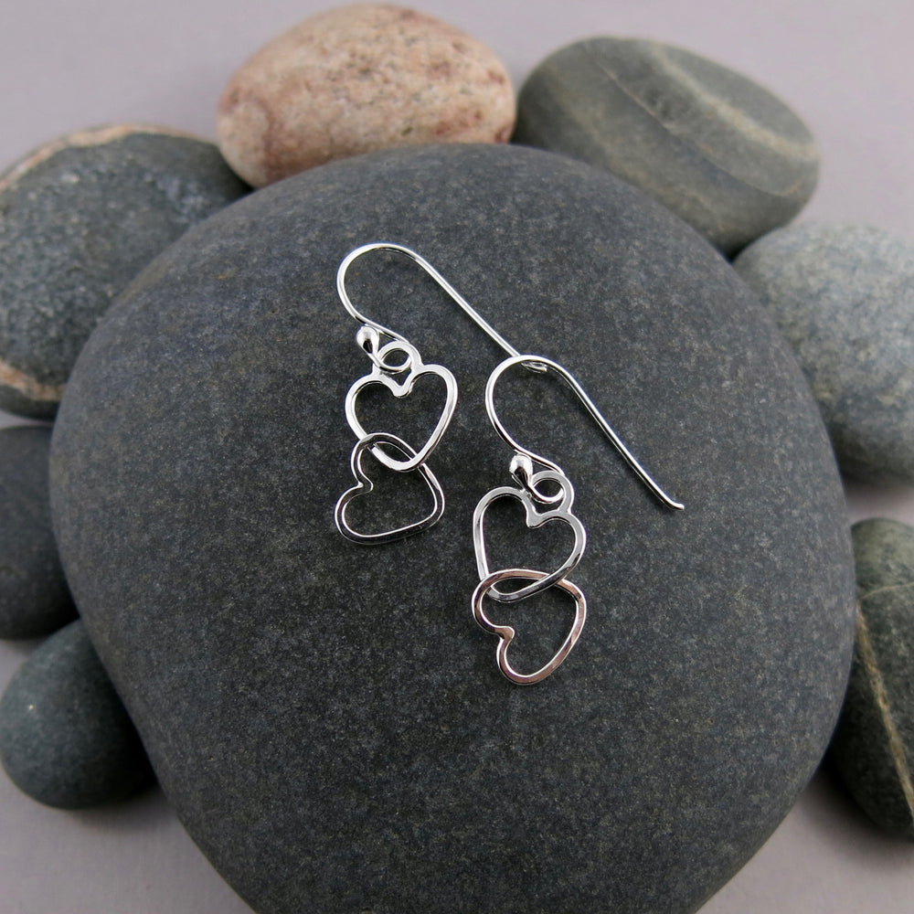 Hearts Embrace Earrings in Sterling Silver by Mikel Grant Jewellery. Artisan made interlocking hearts earrings.