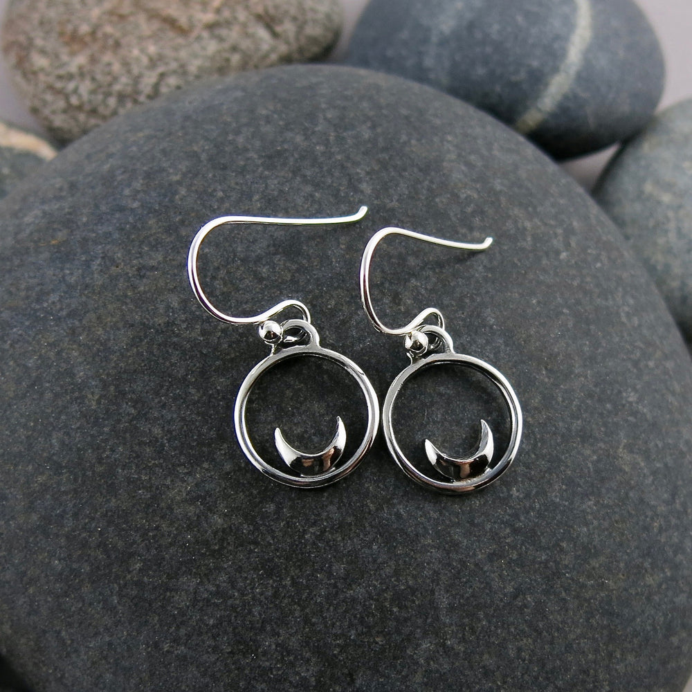 Mini silver crescent moon dream earrings by Mikel Grant Jewellery.
