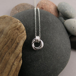 Mini timeless love knot necklace in sterling  silver by Mikel Grant Jewellery.  Artisan made infinite knot jewellery.