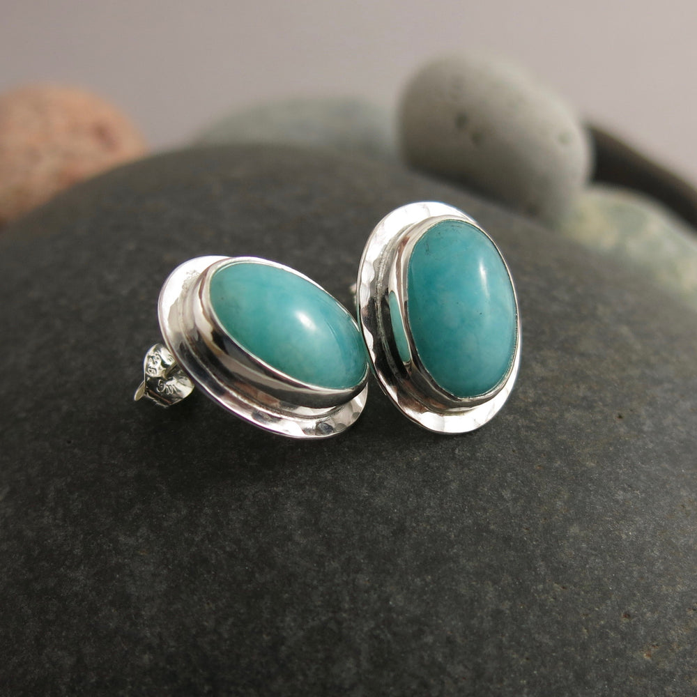 Artisan made sterling silver and natural amazonite oval stud earrings by Mikel Grant Jewellery. Featuring a pair of turquoise-blue semi-precious gemstones.