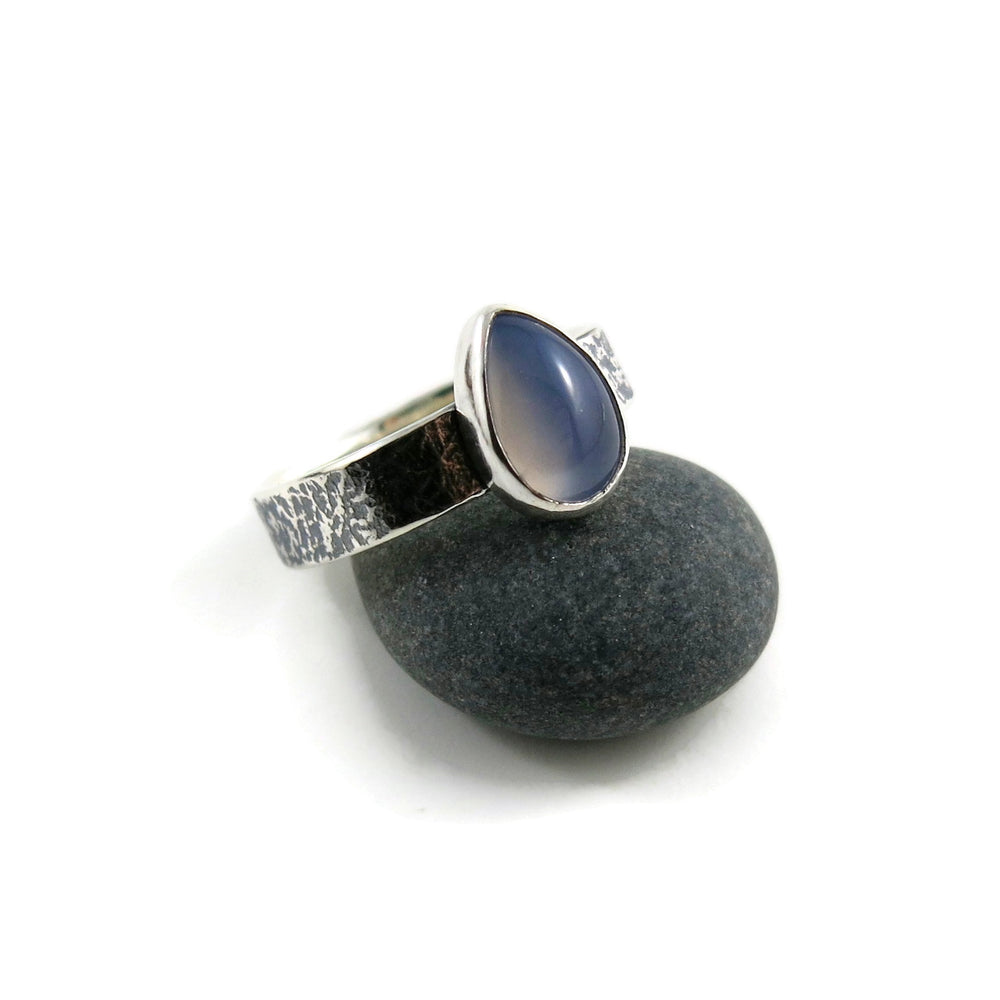 Artisan made chalcedony teardrop on an oxidized textured sterling silver soft square ring by Mikel Grant Jewellery.