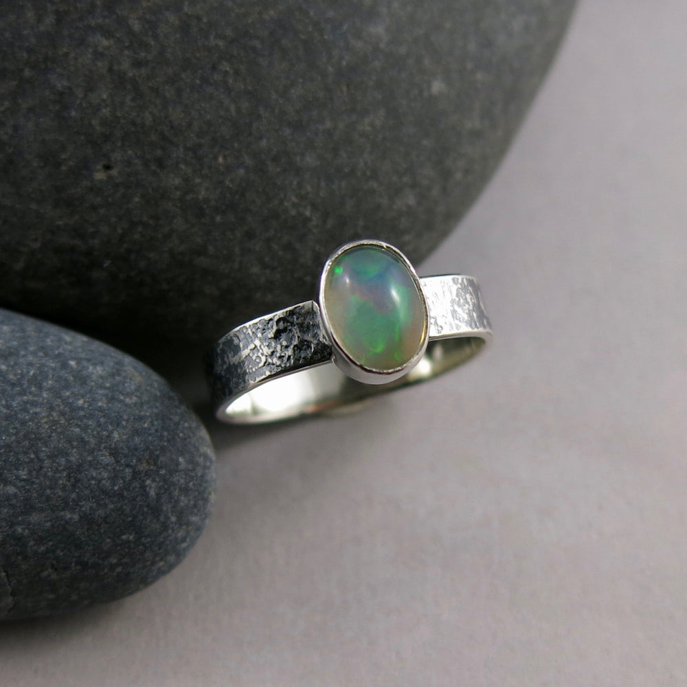 Artisan made Ethiopian opal ring in textured, oxidized sterling silver by Mikel Grant Jewellery.