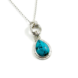 Artisan made Tibetan turquoise love knot necklace in sterling silver by Mikel Grant Jewellery.