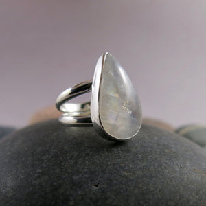 Artisan made rainbow moonstone teardrop ring on a double sterling silver band by Mikel Grant Jewellery.