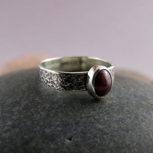 Artisan made natural ruby on an oxidized textured sterling silver soft square ring by Mikel Grant Jewellery.