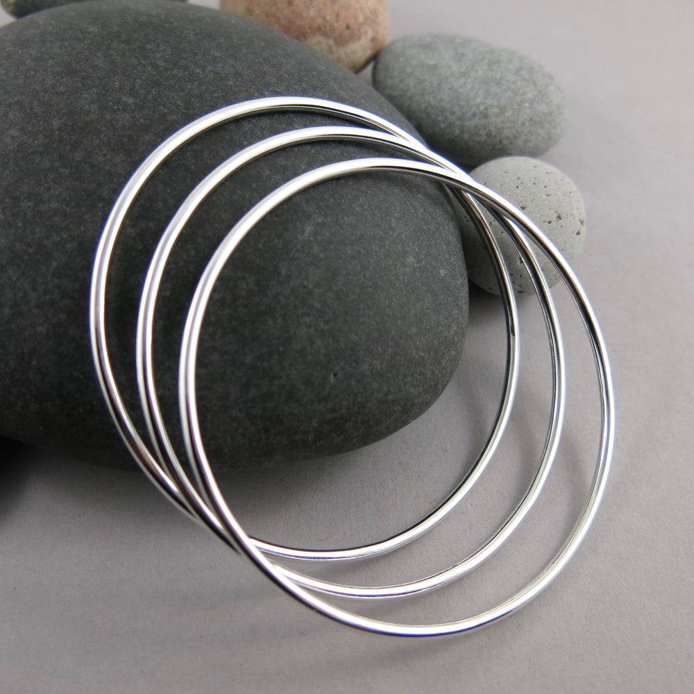 Artisan made thick smooth sterling silver bangle by Mikel Grant Jewellery.