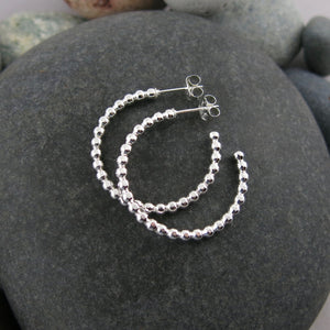 Beaded sterling silver open hoop studs by Mikel Grant Jewellery. Artisan made on the Sunshine Coast of BC.