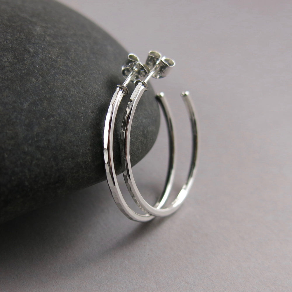 Hammer textured sterling silver open hoop stud earrings by Mikel Grant Jewellery. Artisan made on the Sunshine Coast of BC.
