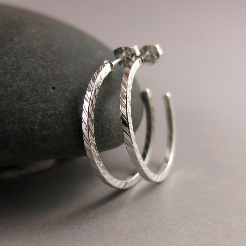 Striped square open hoop studs in sterling silver by Mikel Grant Jewellery. Modern, minimal, geometric, artisan made.