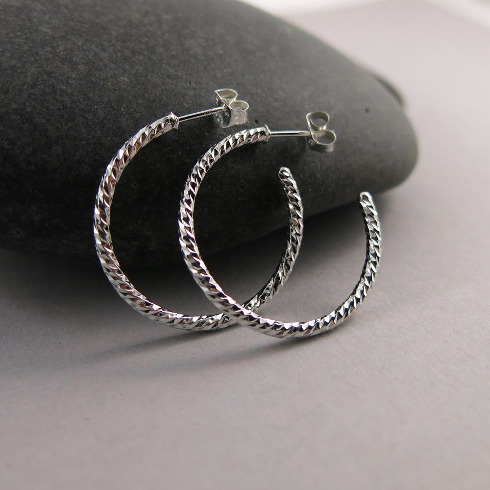 Sterling silver sparkle open hoop stud earrings by Mikel Grant Jewellery. Artisan made on the Sunshine Coast of BC.