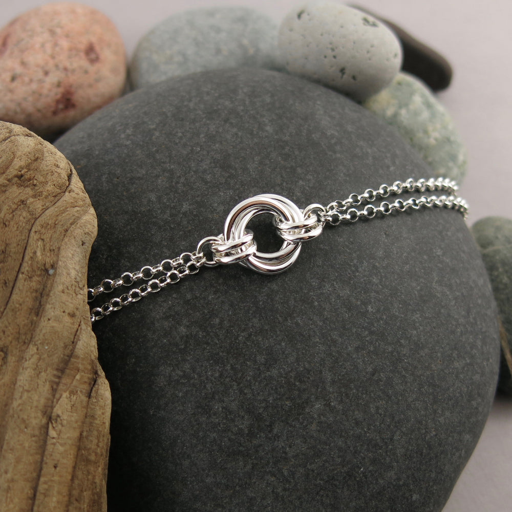 Timeless love knot bracelet in sterling silver with double rolo chain by Mikel Grant Jewellery.  Artisan made endless knot jewellery.