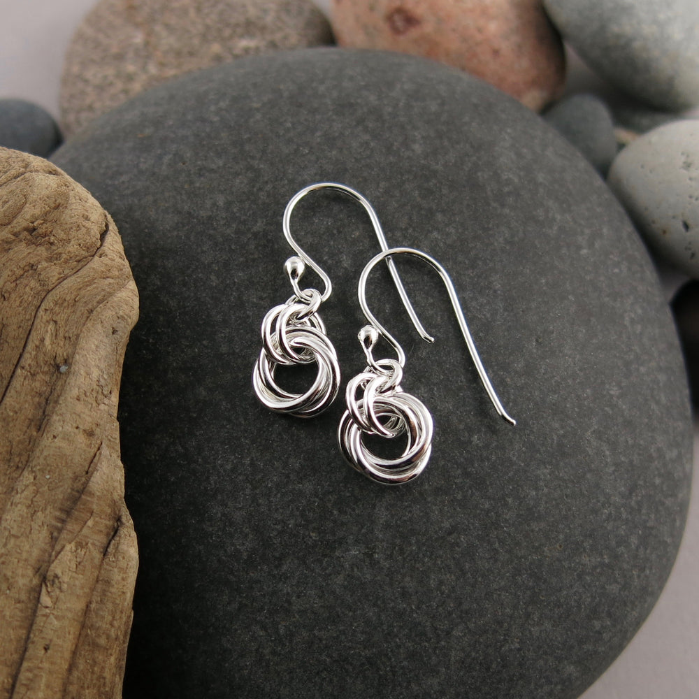 Timeless love knot earrings in sterling silver by Mikel Grant Jewellery.  Artisan made endless knot jewellery.