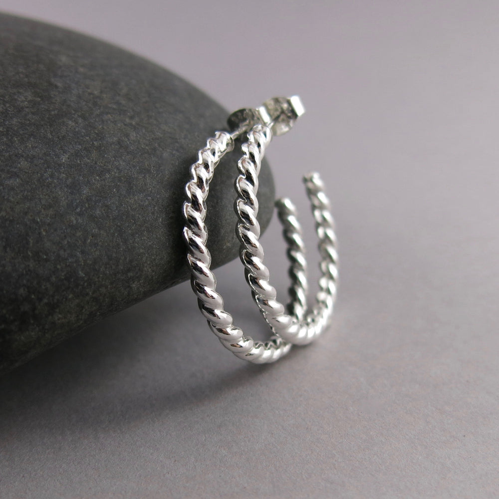 Twisted sterling silver open hoop studs by Mikel Grant Jewellery. Modern, comfortable, artisan made.