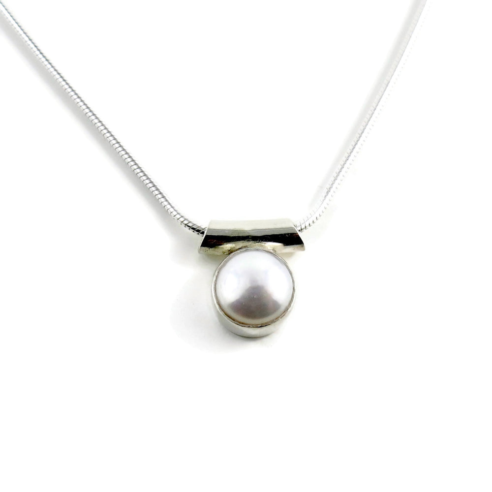 Pearl solitaire necklace by Mikel Grant Jewellery. White button pearl in sterling silver.