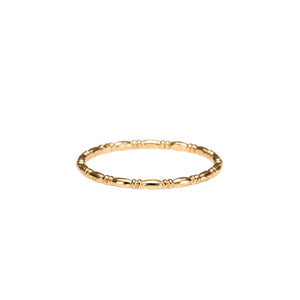 Artisan made gold uniquely patterned stacking ring by Mikel Grant Jewellery.