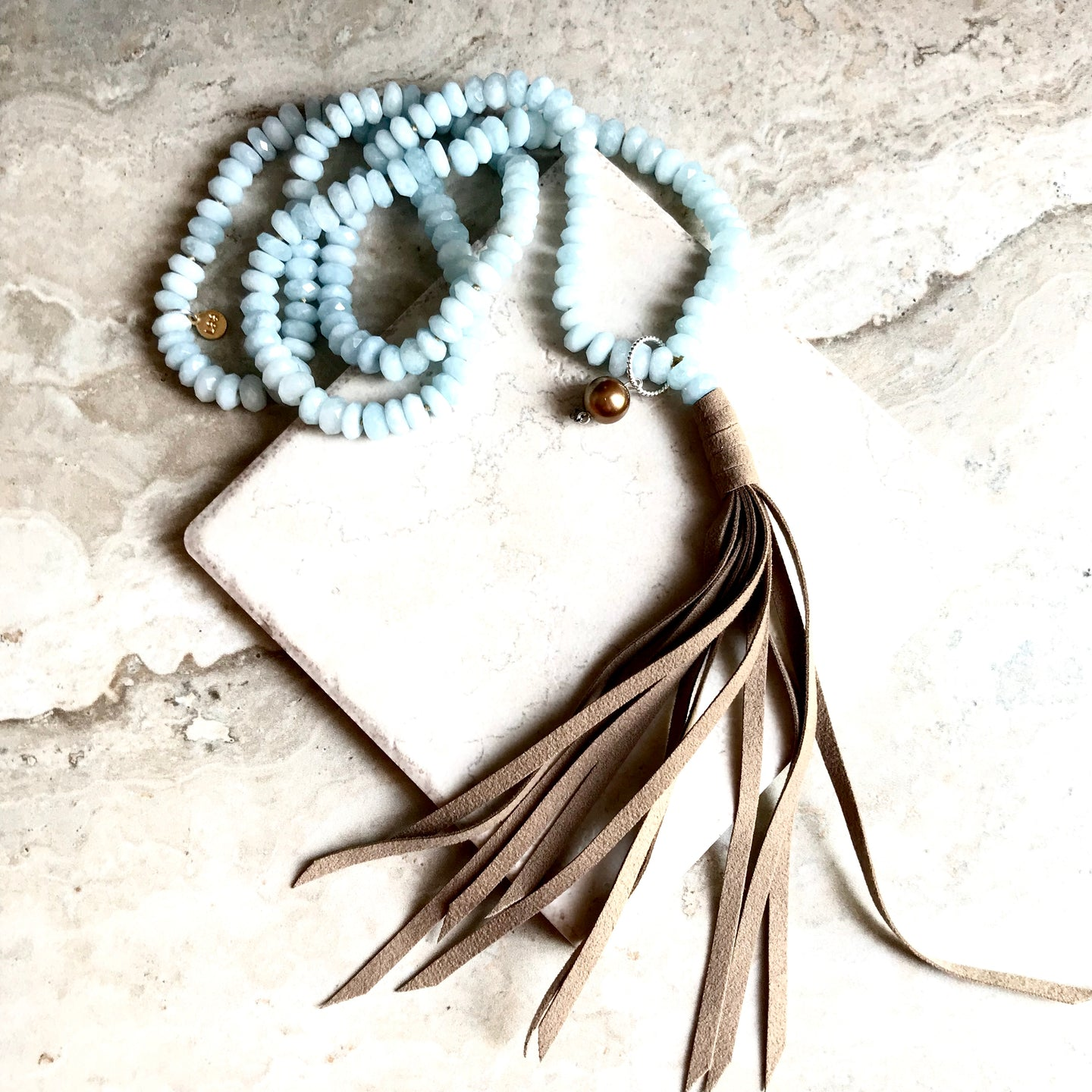Faceted Aquamarine Suede Tassel