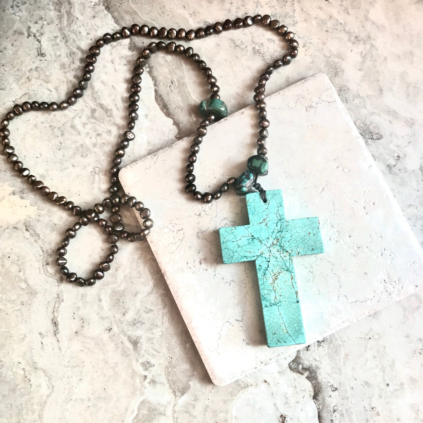Chocolate Pearl Turquoise Howlite Cross