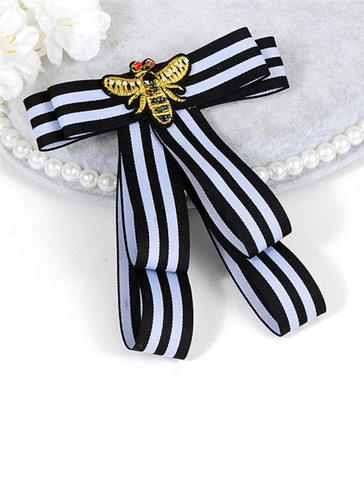 Black and white bow pin
