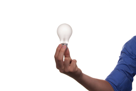 light bulb held in hand