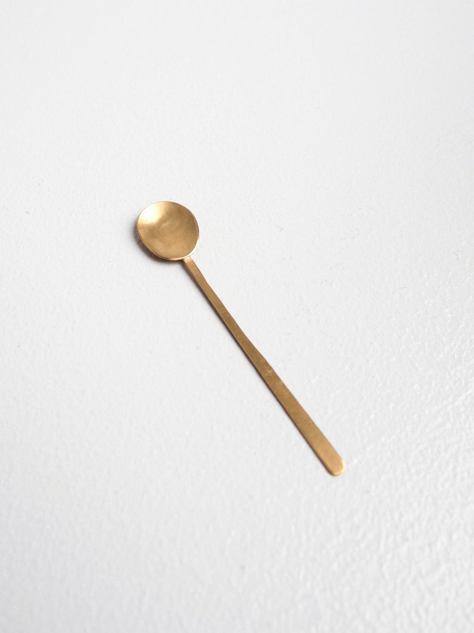 Small spoons, brass