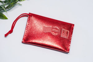postmark_christmas_ornament_2020_red_leather