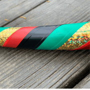 "<img src=""Midnight—Rasta-Beginner-Hula-Hoop.jpg""alt=""holographic gold tape and red, black, green electric tape in a rasta pattern on a beginner hula hoop on a wooden deck"""