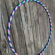 "<img src=""Pink-Color-Bliss-Beginner-Hoop-by-Autumn-Flow.jpg""alt=""Pink, blue, green, red, sparkly color bliss beginner hula hoop on a wood deck background in the sunlight"">"