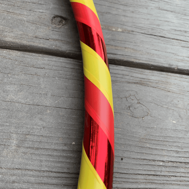 "<img src=""Bell-Pepper-Beginner-Hula-Hoop.jpg""alt=""yellow and red electrical tape with shiny red tape on a beginner hula hoop against wood background"">"