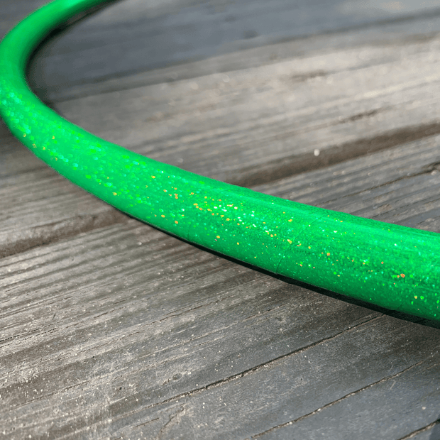 "<img src=""Lime-Green-Holographic-Taped-Hoop-by-Autumn-Flow.jpg""alt=""lime green holographic taped hula hoop against wood background"">"
