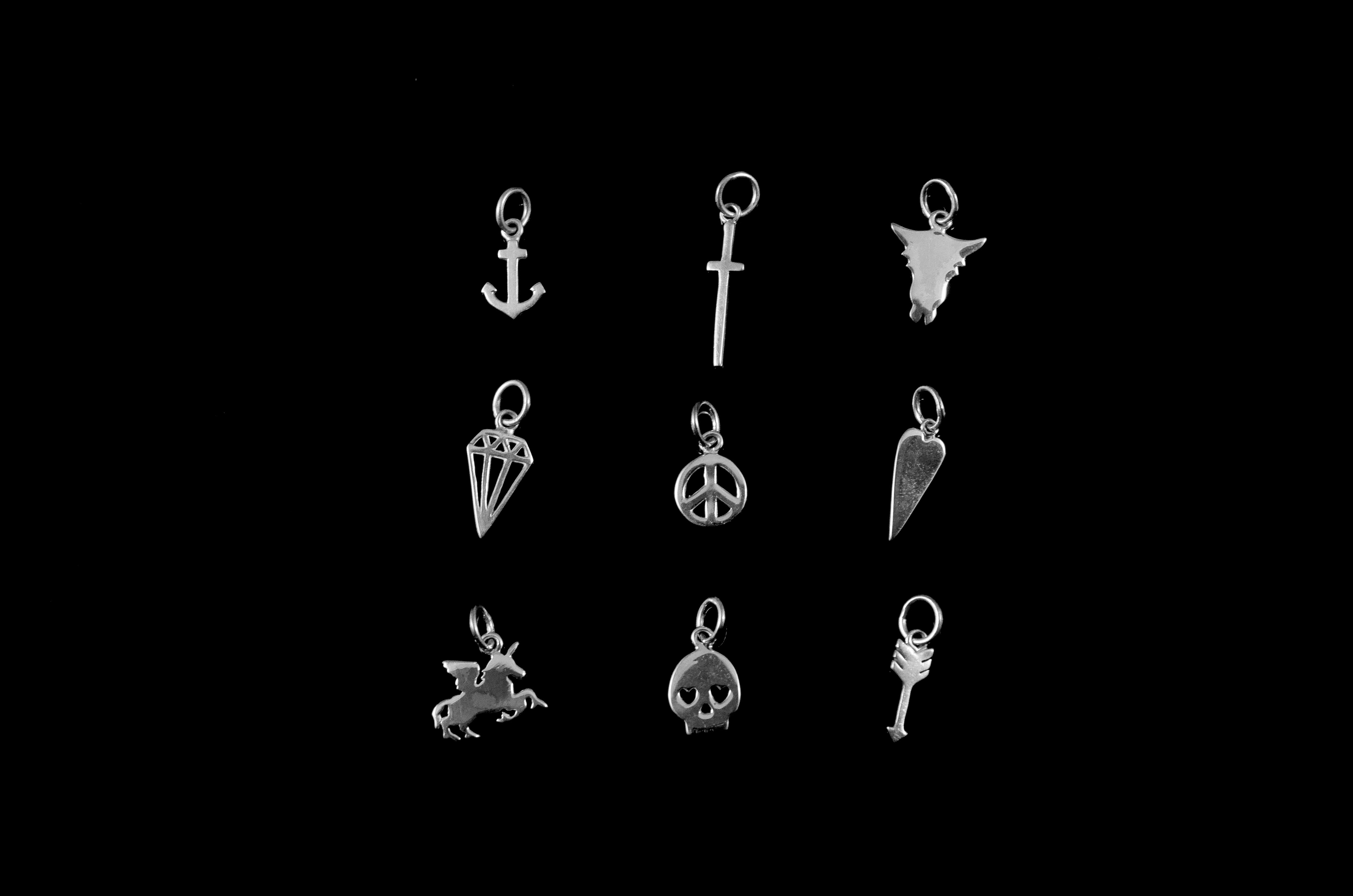 Mini symbolic charms