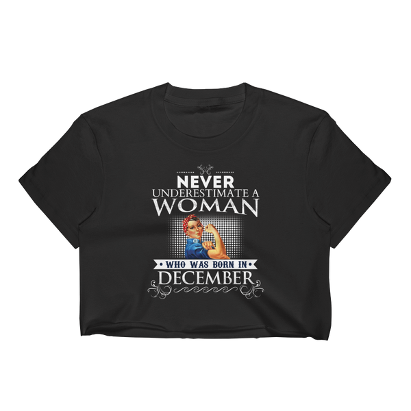 Never Underestimate A Woman Who Was Born In December - Women's Crop Top - Cozzoo
