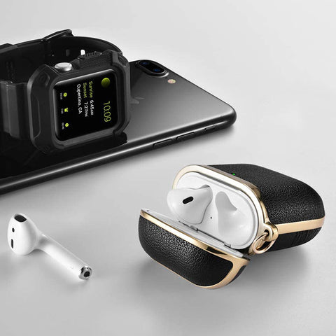 airpods in a leather airpod case beside iphone and iwatch
