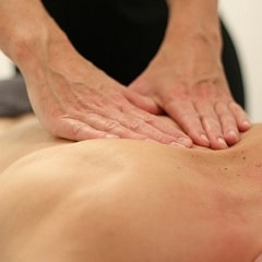 Person giving a Deep Tissue Massage.