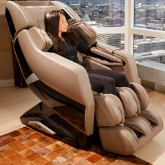 Infinity Riage X3 massage chair with lady sitting in it.