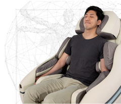 A person sitting in a massage chair.