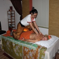 Person performing Thai Massage