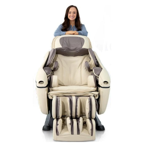 Inada DreamWave massage chair in beige with woman standing behind.