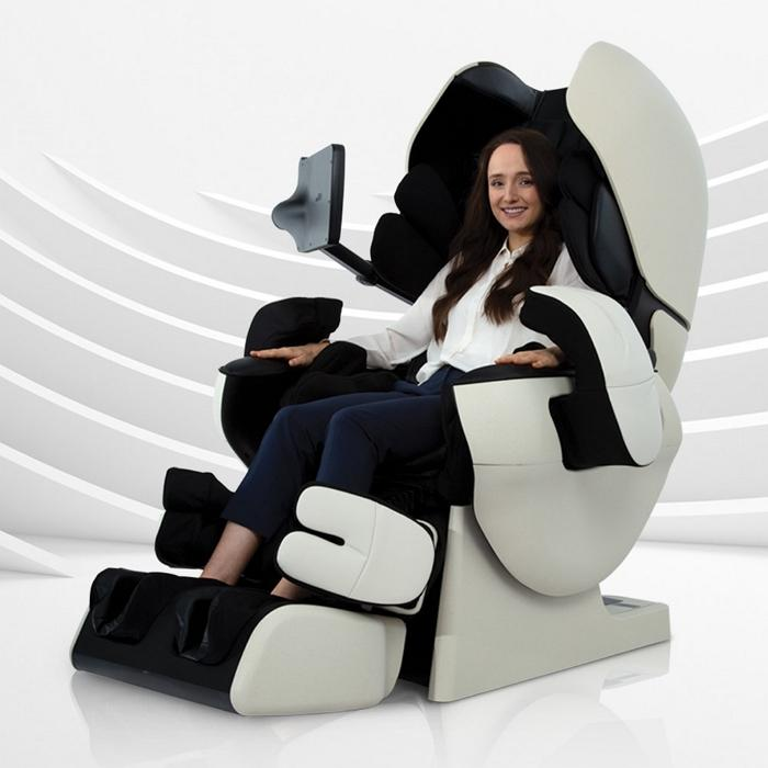 Inada Robo massage chair in Ivory with Black color with a woman sitting in it.