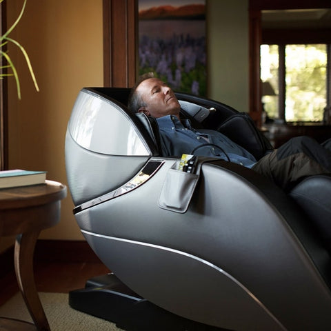 Infinity Genesis Massage Chair in Man Sitting in Zero Gravity Position