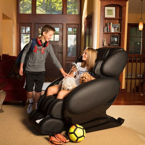 Infinity IT-8500 Massage Chair with a Kid and  a Woman