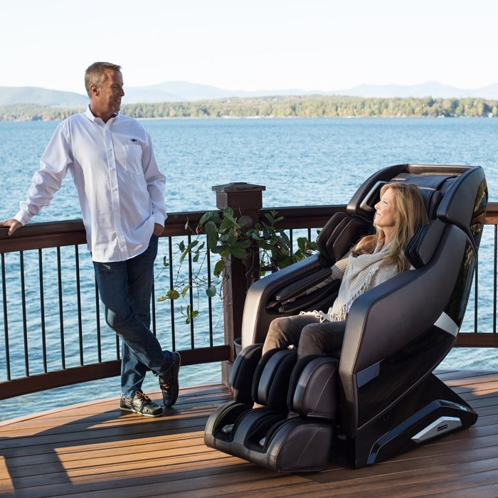 Infinity Riage X3 Massage Chair in Taupe with Man and Woman