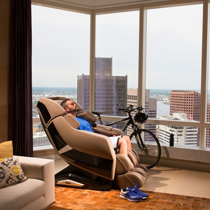 Infinity Riage X3 Massage Chair with Man Sitting and a Bicycle