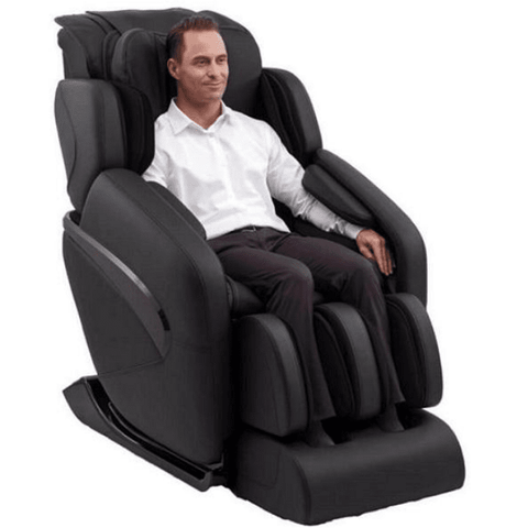 Inner Balance Wellness Jin Massage Chair in black semi side view with person