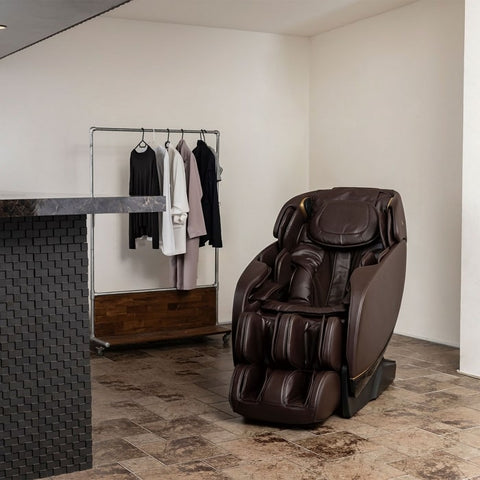 Inner Balance Jin 2.0 Massage Chair with A Cloth Rack Background