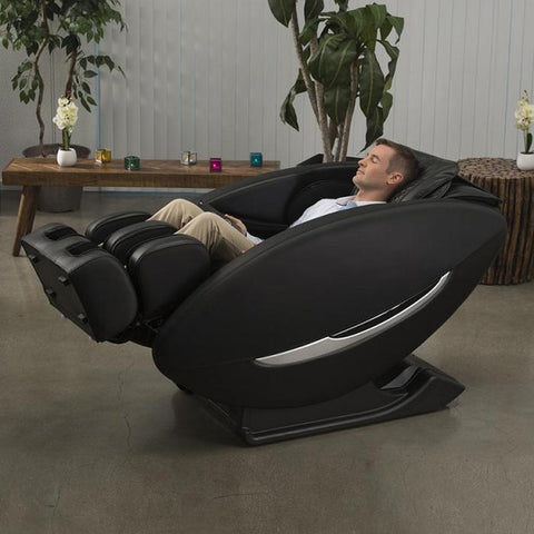 Inner Balance Wellness Ji Massage Chair IMR0047 in fully reclined angled with person in room