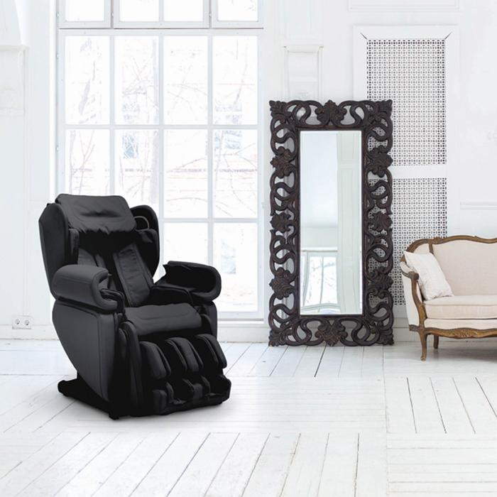 Synca Kagra J6900 Massage Chair in black inside a room.