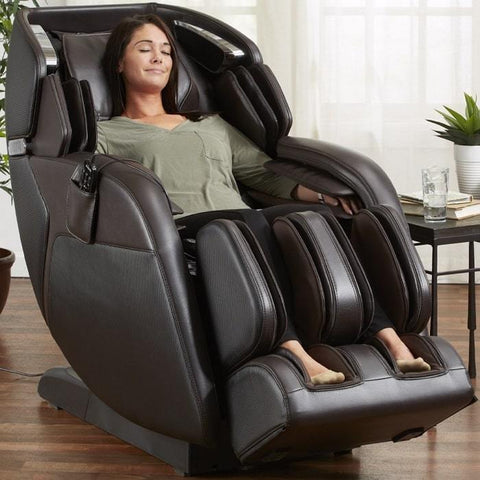 Kyota M673 Kenko Massage Chair in Brown With Woman Relaxing