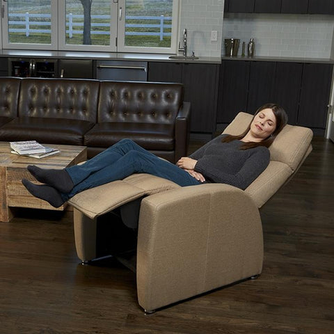 Positive Posture Luma Zero Gravity Recliner in brown with model in room reclined position